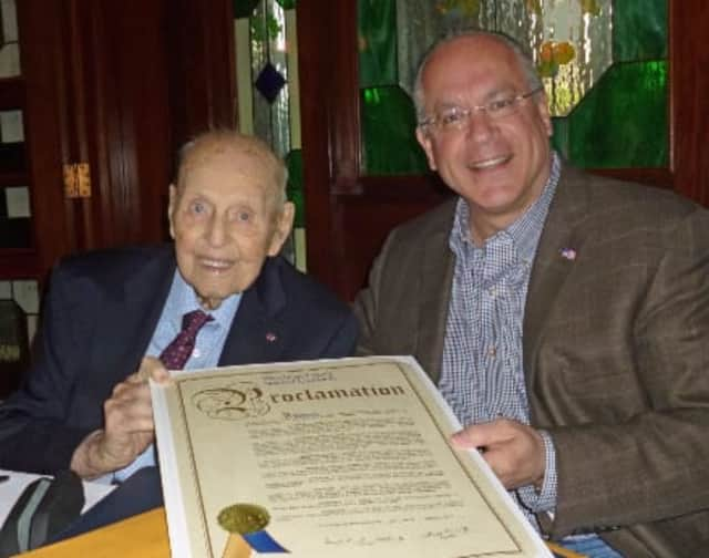 """In celebration of his 100th birthday, Eastchester resident, Alfred J. Fenzel receives from Eastchester Town Supervisor Anthony S. Colavita, a congratulatory proclamation declaring March 12, 2015 to be """"Alfred J. Fenzel Day"""" in Westchester County."""