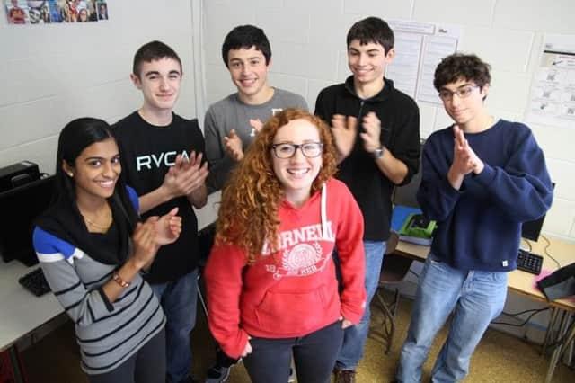 Sarah Marino, center in red sweatshirt, has been named an I-SWEEEP finalist.