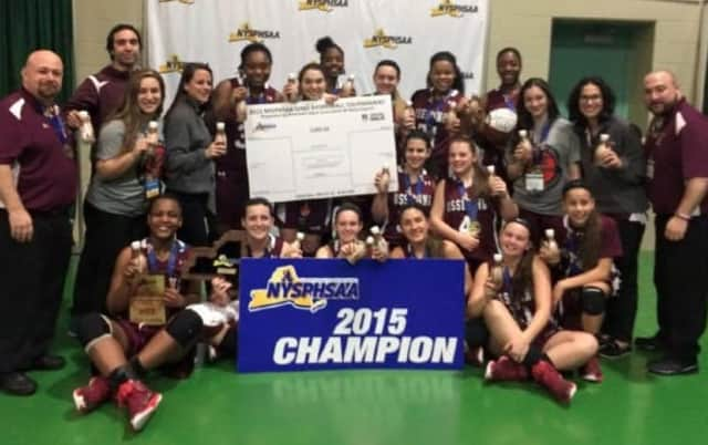 Ossining's varsity girls basketball team celebrates a third straight state title.