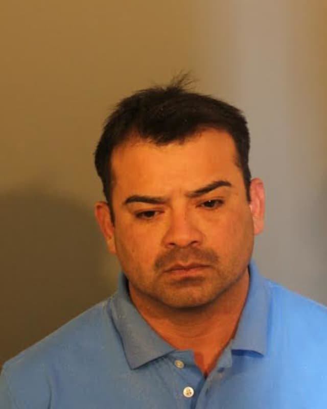 Juan A. Garcia-Perales is charged with sexually abusing two young girls over a three-year time period, police said.