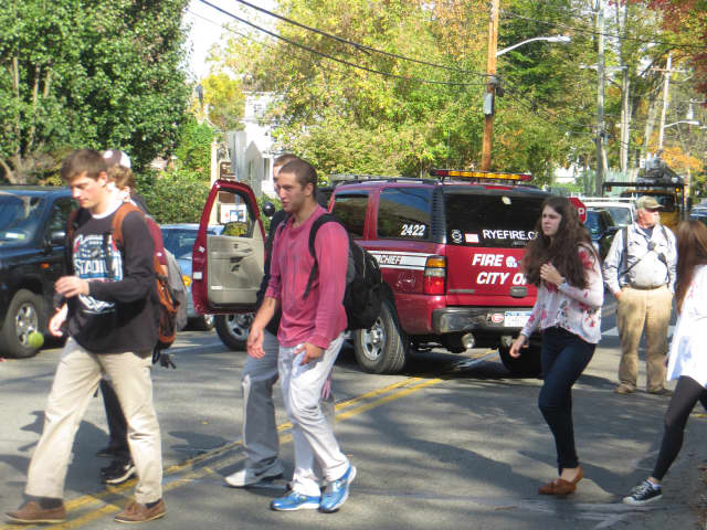 Rye High students return to class Oct. 21, 2014, after the first of four bomb threats during the school year. Police made an arrest on Monday.