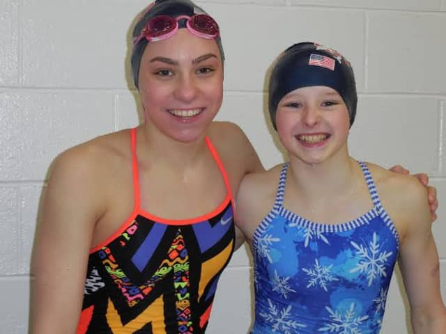 Kate Hazlett, left, and Meghan Lynch won six gold medals each for the Greenwich Dolphins at the Connecticut State Age Group Championships.