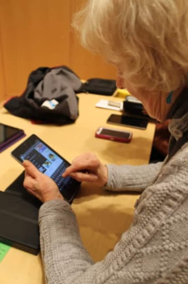 Wilton Library will be upgrading its Wi-Fi system on Tuesday to provide a more robust system as people use more personal devices on a regular basis such as Ann Newton, pictured here.