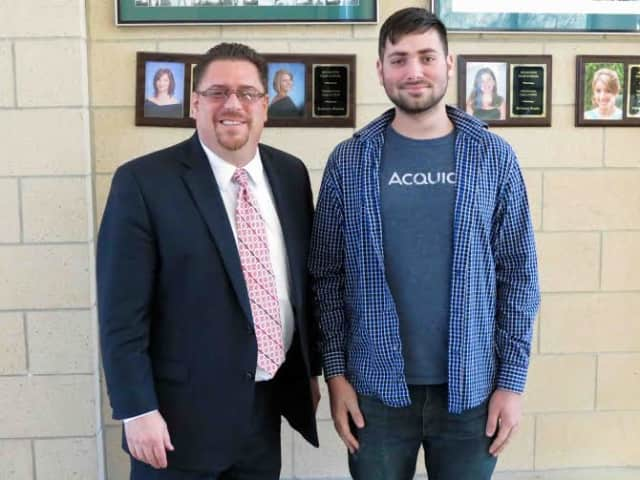 Irvington High School Principal David Cohen is pictured congratulating senior Myles Novick, who was named a finalist in the 2015 National Merit Scholarship Program.