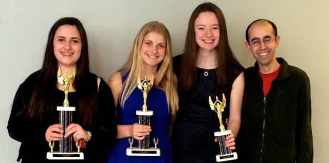 From left, Harrison High School debate team members Amy Geller, Elyssa Alfieri, Sarah Ryan, and Coach Chetan Hertzig. The school's team is ranked No. 1 in New York and No. 6 nationally.