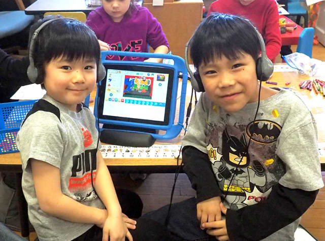 Harrison kindergartners using tablets in school.