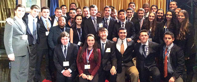 DECA members at Harrison High School recently competed at a state competition in Rochester; three of the students will be attending the nationals in Florida later this month.