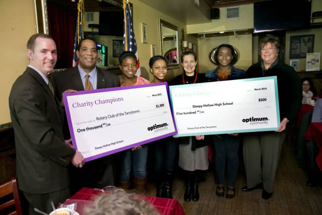 Charity Champions at Sleepy Hollow High School presented $1,000 to The Rotary Club of The Tarrytowns.