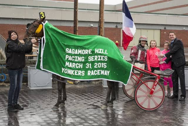 Rediscovery and George Brennan earn trophy at Yonkers Raceway.