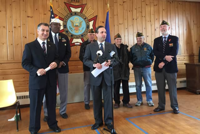 Senators Carlo Leone and Bob Duff, surrounded by veterans at the Darien VFW, announce a bill that would provide 100 percent exemptions on income tax for veterans.