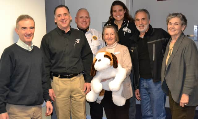 Rye Derby Committee members pictured L to R: Conor O'Driscoll, Gregg Howells, Lt. Scott Craig, Sally Wright (holding Darby the Derby Dog), Susan Gervais, Russell Gold and Penny Cozza.