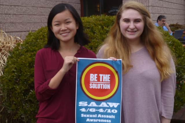 Norwalk High School sophomores Rebecca Gaumerklein, left, and Kassidy Wynne have created events this week at school to raise awareness for sexual assault.