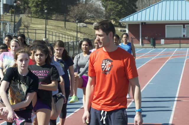 Danbury Hatters coach Nick Fraticelli talks to his team. Fraticelli, coach of the Danbury High School girls' indoor track team, was named the Connecticut Coaches Association Indoor Track Assistant Coach of the Year.