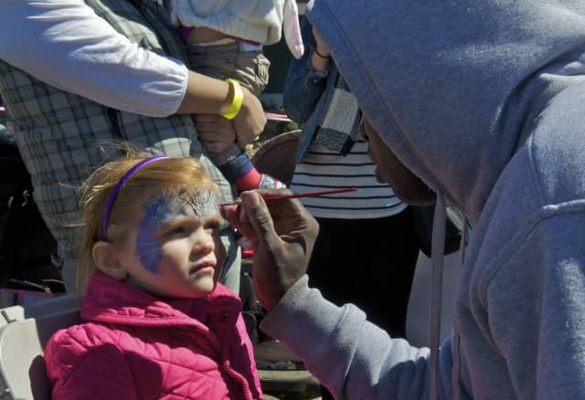 Face painting is one of the offerings at Westorchard Elementary School's Little Westorchard Circus.