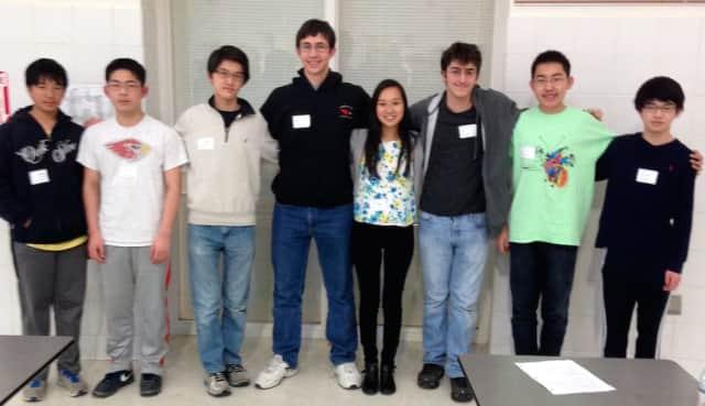 Greenwich High School Math Team members are, from left, William Yin, Jason Shi, Andrew Ma, Michael Kural, Julia Wang, Bennett Brain, Henry Shi and Steven Ma.