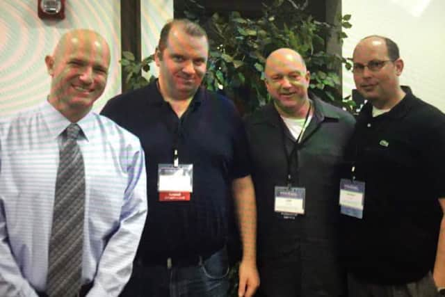 From left, Deputy Superintendent Jeff Gorman, Standards Administrator for Technology Joseph McGrath, Davis Middle School Principal Joshua Whitham and Eric Sheninger, technology pioneer educational leader at the Future Ready Summit.