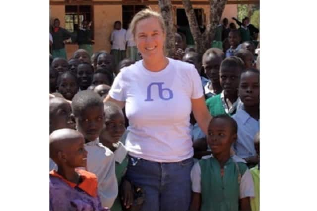 Nancy Budd, a realtor for William Raves in Wilton, helps run a scholarship fund for children in Kenya.