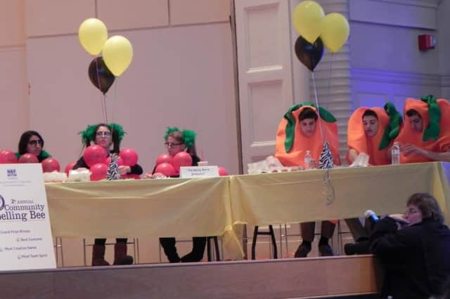 The Norwalk Education Foundation will host its third annual Community Spelling Bee on Thursday at Norwalk City Hall's Concert Hall. Above, costumed spellers enjoy a previous bee.