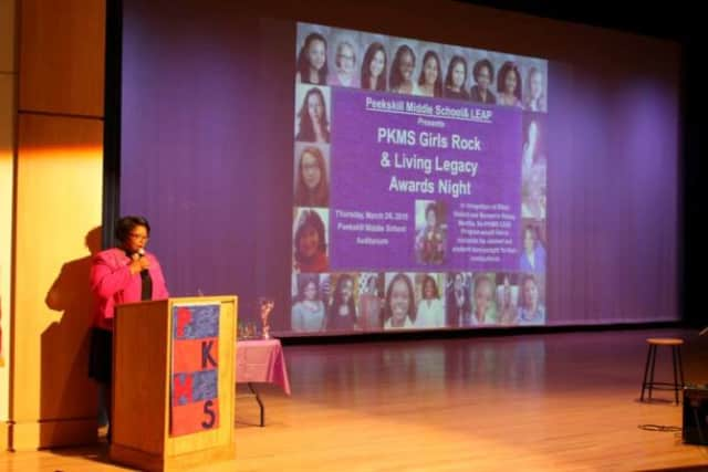 PKMS LEAP Director Naima Smith-Moore announces the honorees at the 2015 PKMS Girls & Living Legacy Awards Night.