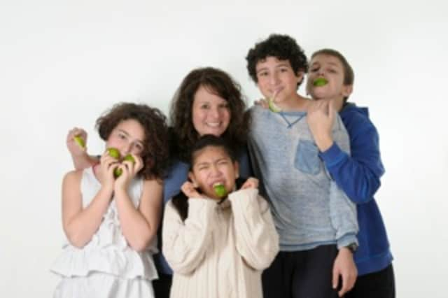 Lisa Kilion with her kids and their friends, taking a bite out of Lyme Disease.