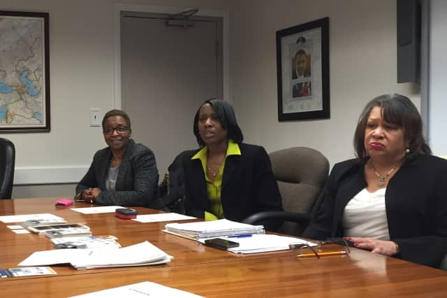Diane Peters, Kimberly Gaddy and Denise Rawles-Smith join at the Carver Center in Norwalk to launch an alumni campaign to raise money for the Carver Foundation's Richard N. Fuller, Sr. Scholarship Fund.