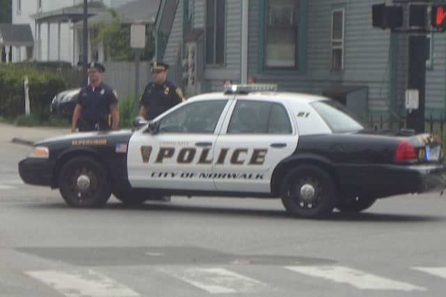 A Norwalk woman was arrested after police said she hit a utility pole while texting and driving.