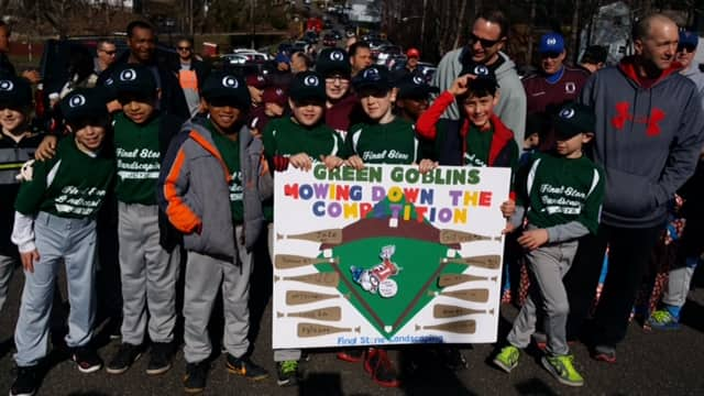 Future sluggers march in Ossining's Little League Parade.