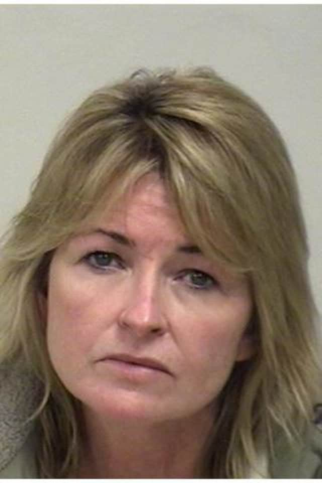 Westport police arrested a Sandy Hook woman after a local attorney complained that she was harassing him.