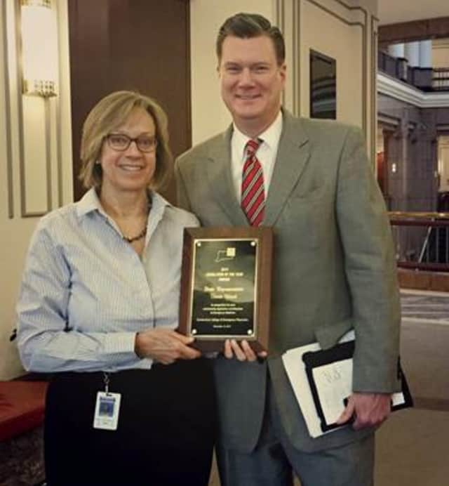 Darien-based state Representative Terrie Wood, left, recently received the Legislator of the Year award from Michael Dugan, right, of the Connecticut College of Emergency Physicians.