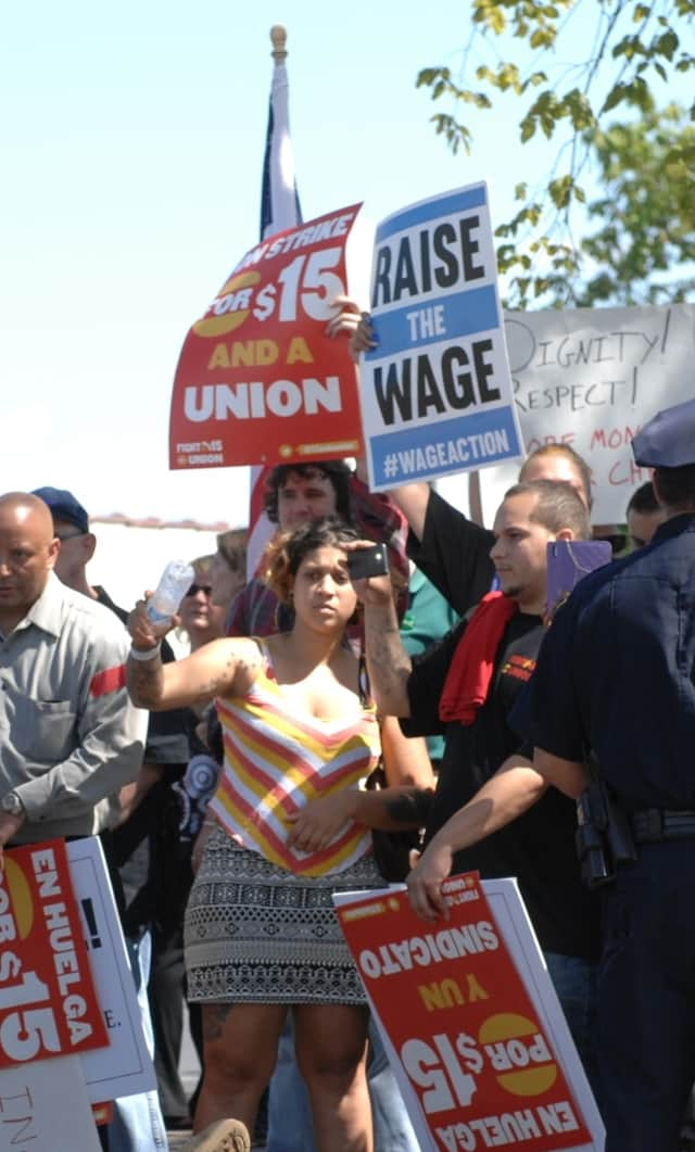 Workers rally for $15 per hour wages last year in Hartford.