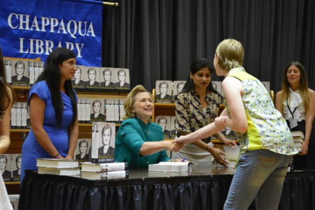 Hillary Clinton gives a handshake during her June 2014 book-signing stop at the Chappaqua Library.