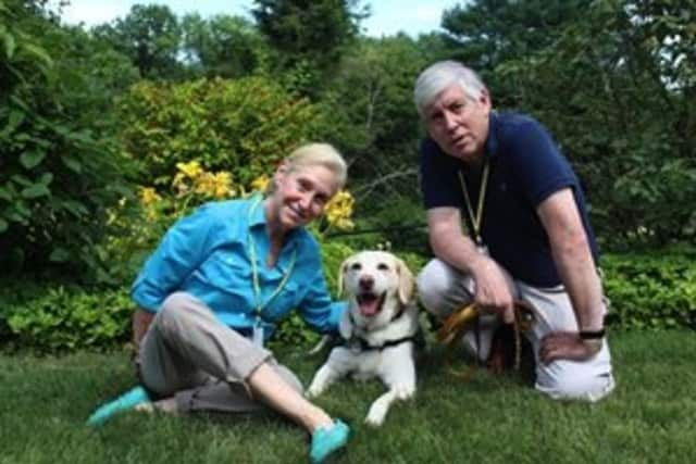 Jane Paley and Larry Price of Easton visit Silver Hill Hospital in New Canaan with their dog, Hooper.