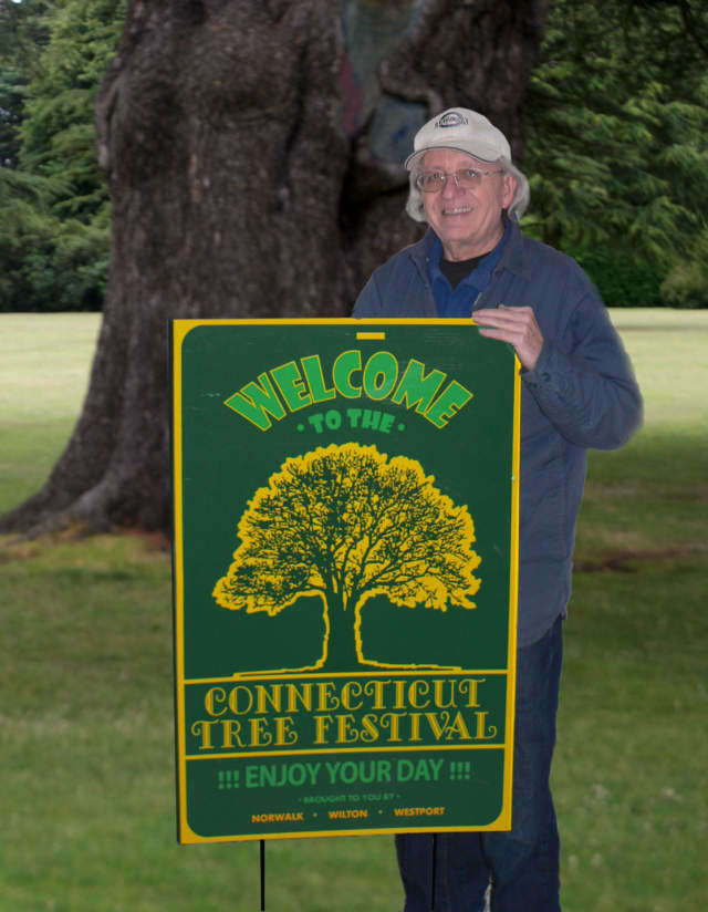 Ron Muller displays signs he created for the Connecticut Tree Festival.