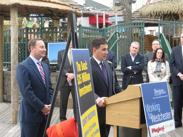 Nicholas Singer, co-founder of Standard Amusements LLC, center, with Westchester County Executive Rob Astorino at Playland on Tuesday.