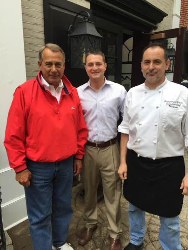U.S. House Speaker John Boehner, posed last month with the general manager and executive chef of The Goose American Bistro & Bar in Darien, Conn. Boehner often frequented restaurants and golf courses in Harrison and Rye when he traveled to New York.