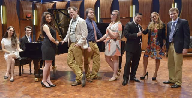 Ten music students at Danbury's Western Connecticut State University and one alumna of the college recently qualified for a national singing competition.