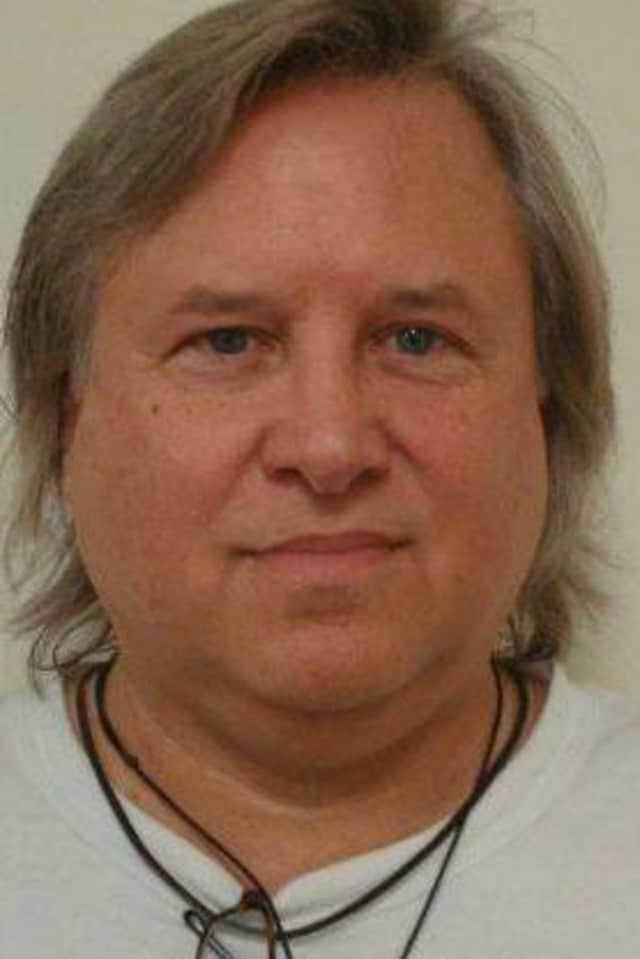 Kevin Kolenda, 57, of Norwalk was charged with running an insurance scam out of Washington state.