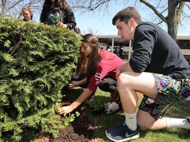 Students planted flowers in honor of Earth Day.