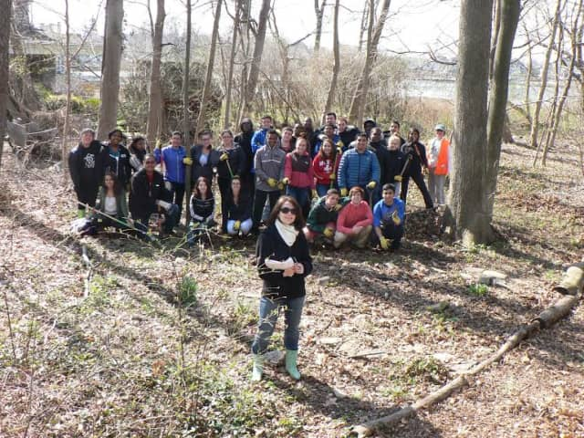 Norwalk High School teacher Juliette Turek and some of her science students join an Earth Day cleanup with environmental activist Mary Verel, at right.