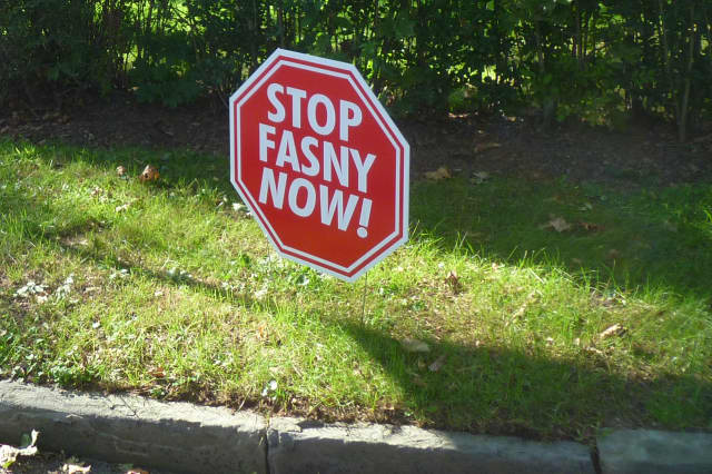 Signs protesting the proposed FASNY school dot stretches of North Street (Route 127) near White Plains High School.