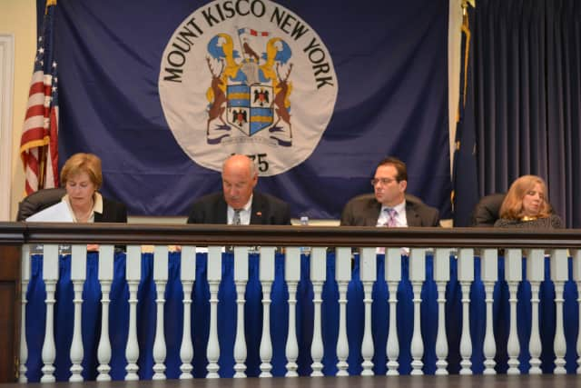Mount Kisco's village board approved a contract to consolidate police services with the county.