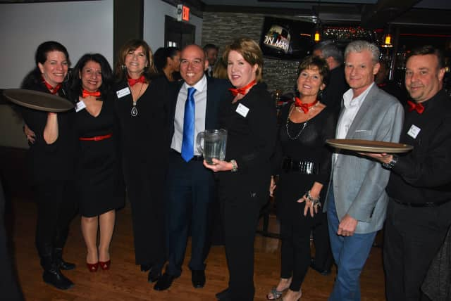 From left, Diane Butterman, Carol Christiansen, Celeste Boglioli, Lou Cardillo, Melissa Reilly, Susan Salomone, Steve Salomone and Phil Risi recently participated in a KW Now Serving charity event in Granite Springs.