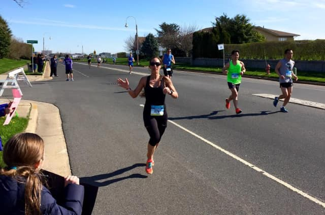 Norwalk's Shannon Whipple runs during Sunday's New Jersey Marathon. She won her age group with a personal best time of 3:18:25.