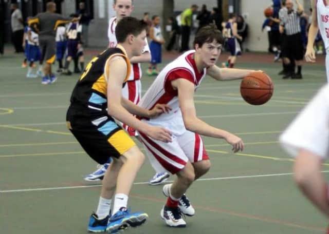 Staples High sophomore, Justin Seideman advances the ball for Academic Basketball Club's U-16 team.