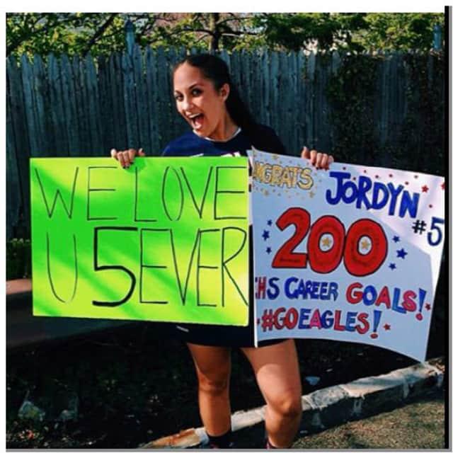 Eastchester High School senior Jordyn DiCostanzo scored her 200th career varsity goal on Saturday.
