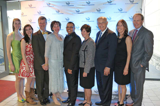 From left,  Hannah, Sarah, Michael, and Nancy Herde of Boston (formerly of New Canaan); Dr. Brian Davis, president of The Maritime Aquarium; Louise and Michael Widland of Norwalk; and Kit and Rob Rohn of Darien.