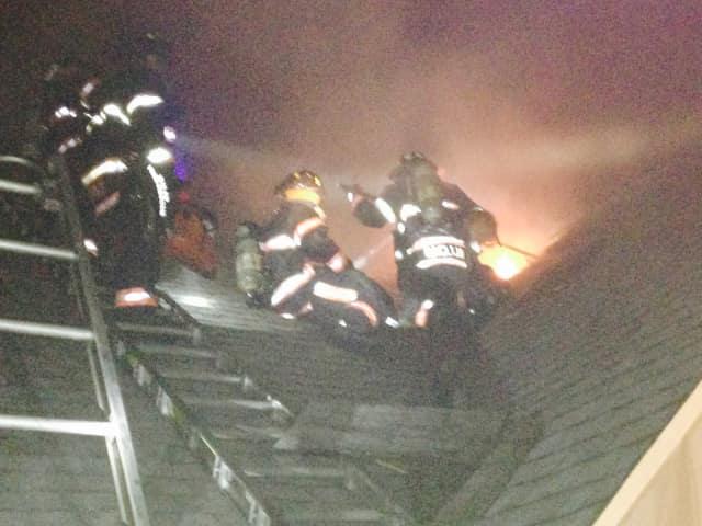 Yonkers firefighters battle the blaze.