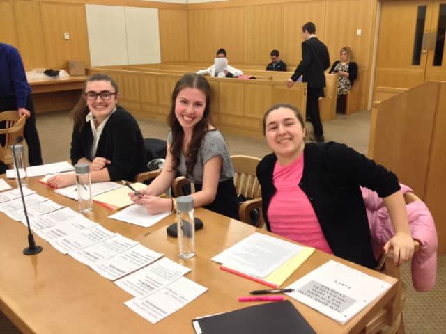 From left, John Jay High School mock trial team members Tara Carroll, Katie Ricca, and Hannah Shaw argued as the plaintiff team versus Clarkstown South during a recent competition at the Westchester County Courthouse.
