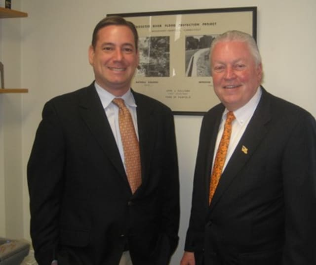First Selectman Mike Tetreau welcomes Brian Carey to his new office as conservation director for the town of Fairfield.