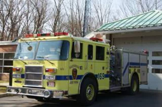 Authorities are battling a brushfire in Hartsdale near the Metro-North tracks.